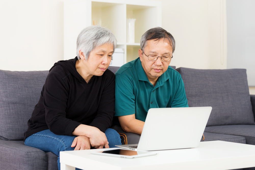 Asian old couple using laptop